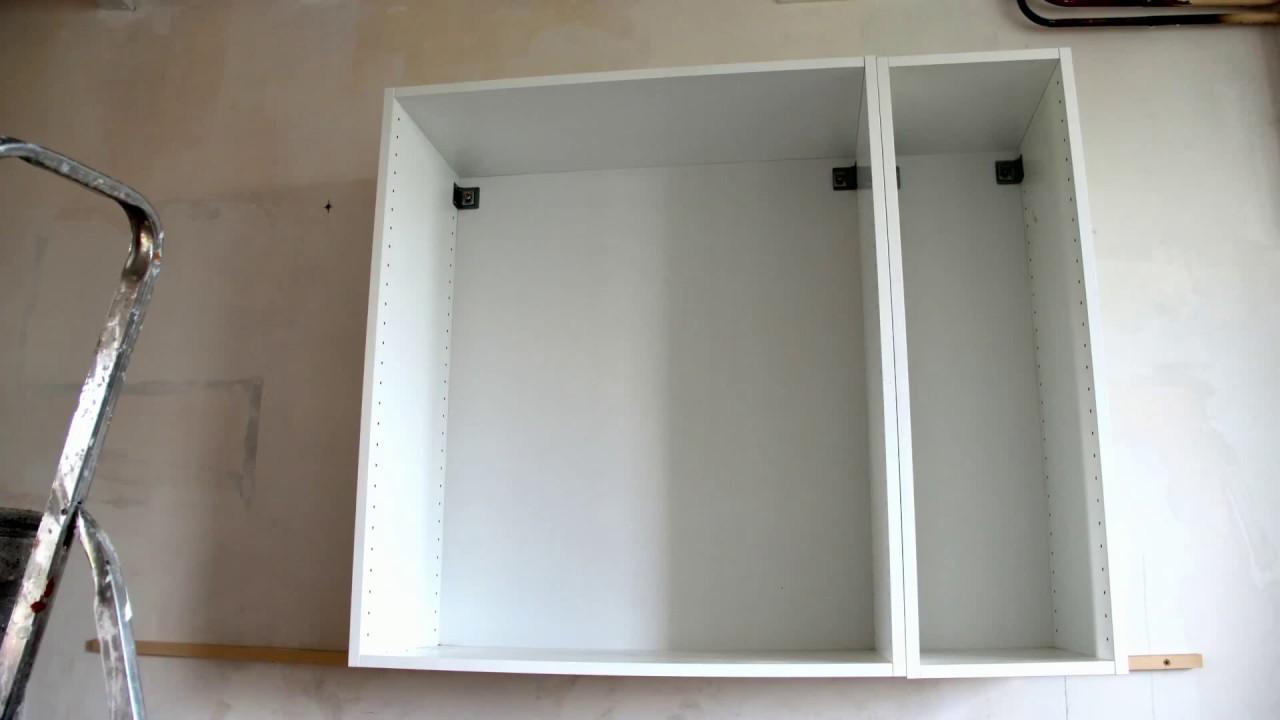 fixer un meuble au mur